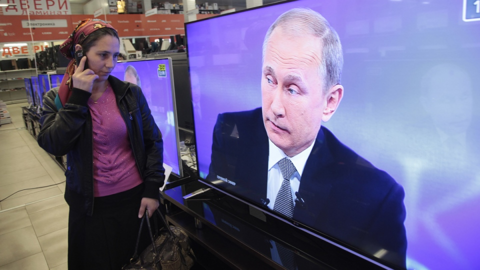 Russian President Vladimir Putin appeares on TV