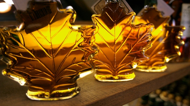 In this Feb. 25, 2009 file photo, maple syrup bottles line a shelf at the Morse Farm Maple Sugarworks in East Montpelier, Vt. (AP / Toby Talbot)