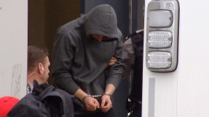 One of the four members of the United Kingdom Naval Service charged with sexual assault is led out of a Halifax court on Friday, April 17, 2015.