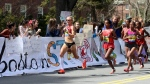 Shalane Flanagan leads Buzunesh Deba, of Ethiopia, and Mare Dibaba, also from Ethiopia, and the elite pack past Wellesley College during the 118th Boston Marathon in Wellesley, Mass., April 21, 2014. (AP / Mary Schwalm, File)