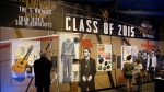 People look at the Class of 2015 exhibit at the The Rock and Roll Hall of Fame and Museum Friday, April 17, 2015, in Cleveland. (AP / Tony Dejak)