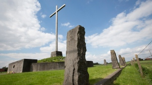 In this Saturday, May 3, 2014 file photo, a memorial surrounded by standing stones commemorates those who lost their lives as a result of the first gas attacks during World War I in Steenstrate, Belgium. (AP / Virginia Mayo, File)