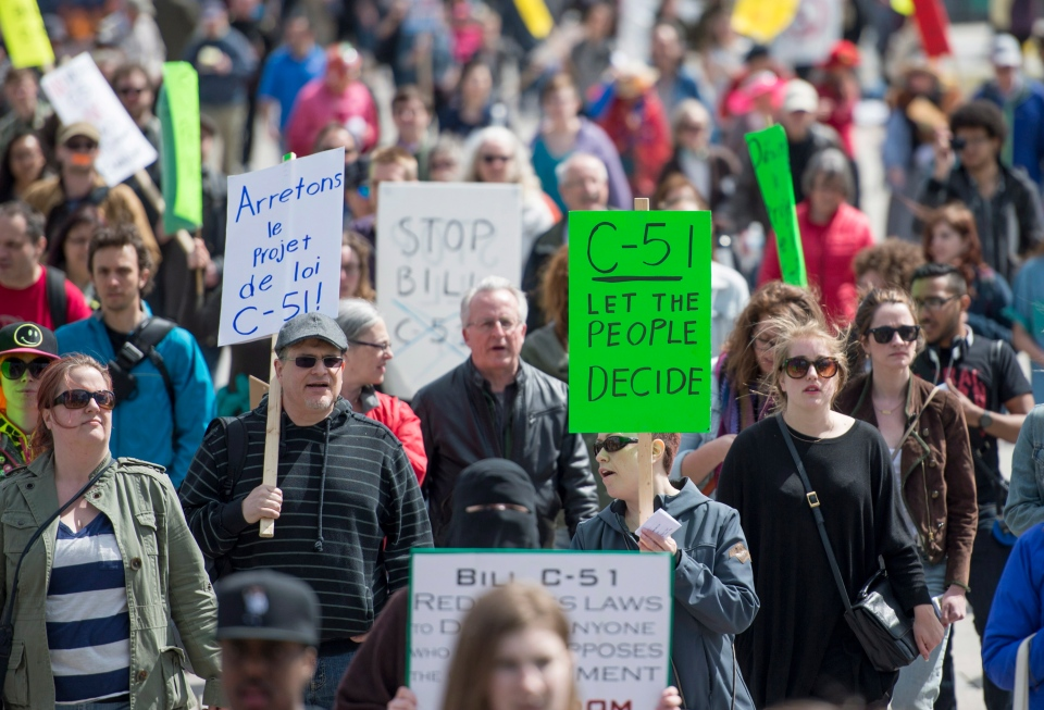 People arrive to protest on Parliament Hill during a day of action against Bill C-51, the government's proposed anti-terrorism legislation in Ottawa on April 18, 2015. (Justin Tang / THE CANADIAN PRESS)