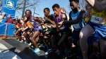 The elite runners start the Boston Marathon 5k race in Boston, Saturday, April 18, 2015. The 119th Boston Marathon will be run on Monday. (AP Photo/Michael Dwyer)