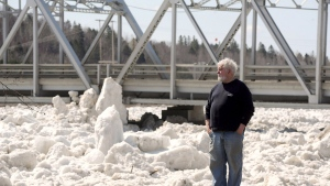 Terry Ritchie, mayor of the Village of Perth-Andover, looks out at the ice jam on the St. John River Sunday, April 19, 2015. (Stephen MacGillivray / THE CANADIAN PRESS)
