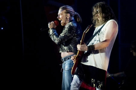 Axl Rose and lead guitarist Robin Finck of Guns N' Roses performing in Denmark in 2006.