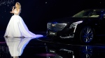 A singer performs near a Cadillac CT6 ahead of the Auto Shanghai show, on April 19, 2015. (AP / Ng Han Guan)