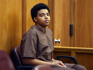 Marc Wabafiyebazu, 15, appears in adult criminal court for his arraignment, Monday, April 20, 2015, in Miami. (Walter Michot/The Miami Herald via AP, Pool)