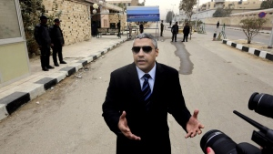 Canadian journalist Mohamed Fahmy speaks before his retrial in Cairo, Egypt, on Monday, Feb. 23, 2015. (AP / Amr Nabil)