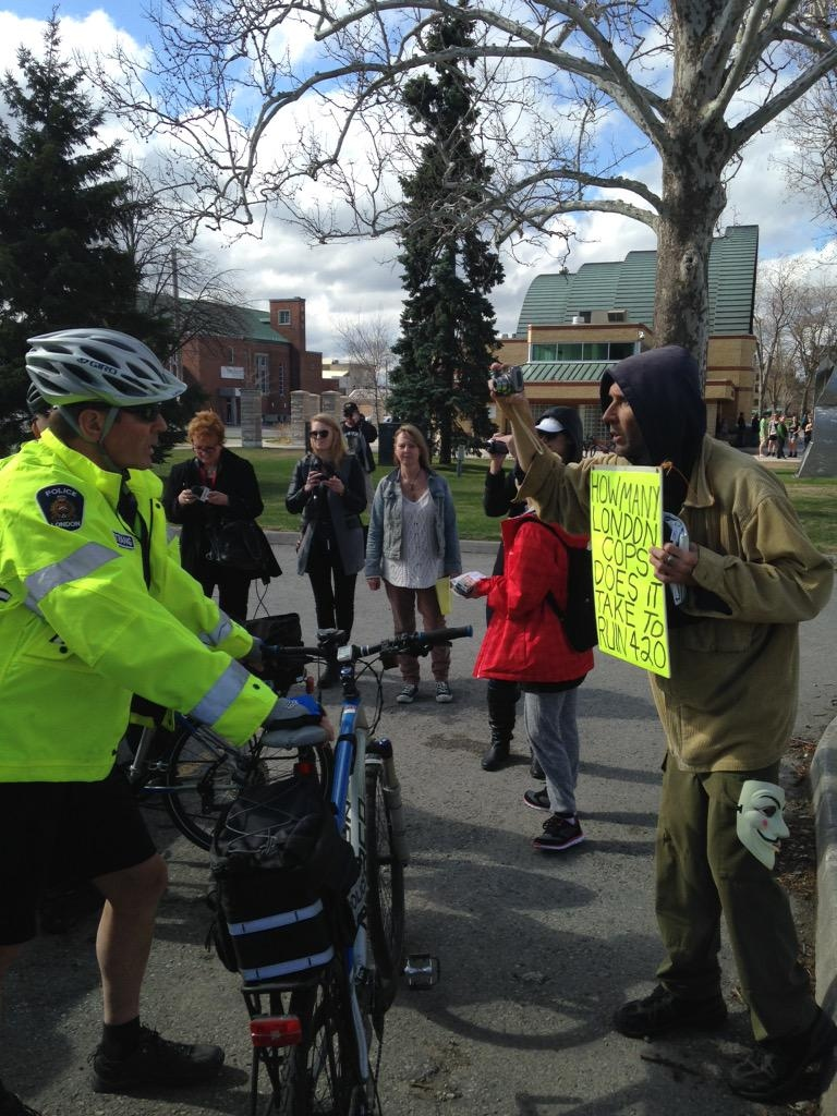 A London police officer and a protester face each other during a 4/20 rally in Victoria Park on Monday, April 20, 2015. (Reta Ismail / CTV London)