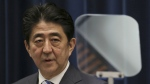 Japanese Prime Minister Shinzo Abe delivers a speech during a press conference at his official residence in Tokyo on the eve of the fourth anniversary of the March 11, 2011 earthquake and tsunami on March 10, 2015. (AP / Eugene Hoshiko)