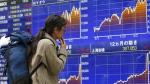 A man looks at an electronic stock indicator of a securities firm in Tokyo on April 21, 2015. (AP / Shizuo Kambayashi)