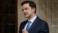 Minister of Employment and Social Development Pierre Poilievre answers a question during Question Period in the House of Commons in Ottawa on April 20, 2015. (Sean Kilpatrick / THE CANADIAN PRESS)