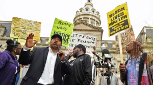 Edward Brown speaks at a protest outside City Hall about Freddie Gray in Baltimore on April 20, 2015. (AP / The Baltimore Sun, Amy Davis)