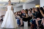 In this April 18, 2015 photo, a model wears a creation from the Oscar de la Renta Bridal Spring 2016 collection in New York. (AP Photo/Mary Altaffer)