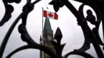Centre Block's Peace Tower is shown through the gates of Parliament Hill in Ottawa on Tuesday, April 21, 2015. (Justin Tang / THE CANADIAN PRESS)