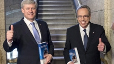 PM Harper and Joe Oliver with the budget