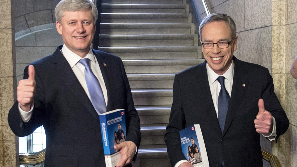 Prime Minister Stephen Harper stands with Finance Minister Joe Oliver as he arrives to table the budget on Parliament Hill in Ottawa on Tuesday, April 21, 2015. (Justin Tang / THE CANADIAN PRESS)