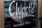 This Tuesday, Jan. 28, 2014 file photo shows the door at a Chipotle Mexican Grill in Robinson Township, Pa. (AP / Gene J. Puskar)