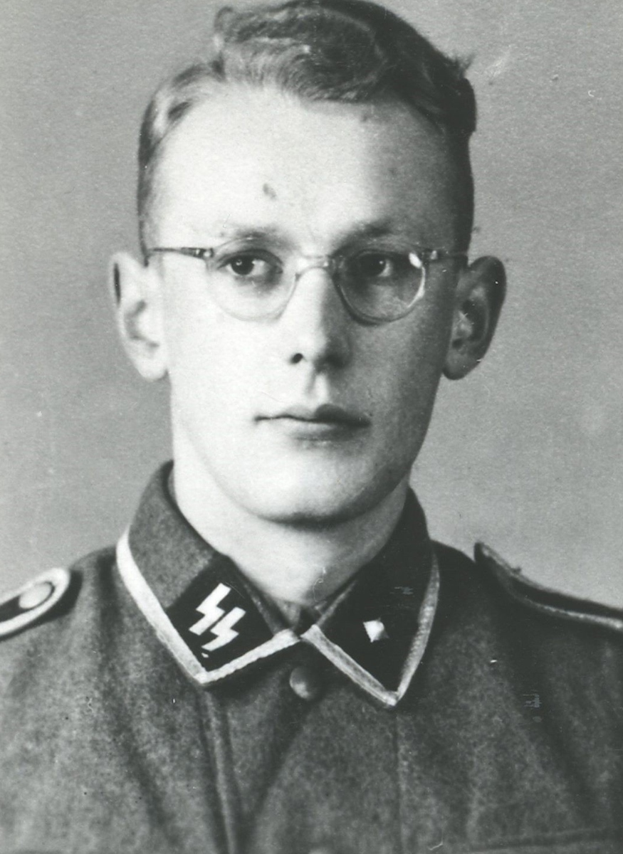 This undated photo made available by the Auschwitz-Birkenau Memorial and Museum, in Oswiecim, Poland, shows the former Auschwitz-Birkenau guard Oskar Groening as a young man in an SS uniform. (Museum Auschwitz-Birkenau via AP)
