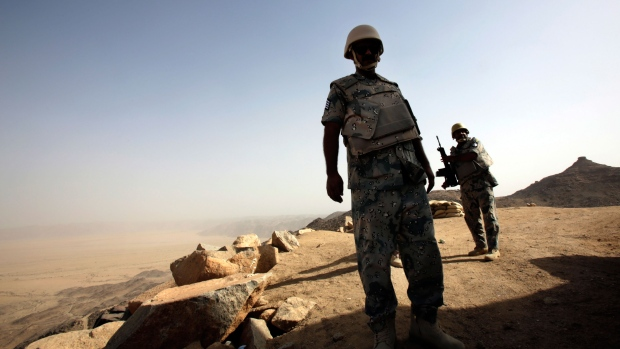 Saudi soldiers stand at border of Yemen