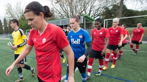 Canadian women's soccer team member Christine Sinclair leads her team on to the field during a training session in Vancouver, B.C. Wednesday, April 21, 2015. (THE CANADIAN PRESS / Jonathan Hayward)