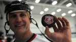 Paul Coffey holds up a Juno Cup puck in Ottawa on March 30, 2012. (THE CANADIAN PRESS / Sean Kilpatrick)