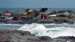 Waves pound the shore in Peggy's Cove, N.S., on Sunday, Dec. 30, 2012. (Andrew Vaughan / THE CANADIAN PRESS))