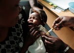 A mother holds her baby as she receives a new malaria vaccine in Kombewa, Kenya in this Oct. 30, 2009 file photo. (AP / Karel Prinsloo)