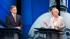 Alberta Progressive Conservative leader Jim Prentice listens to NDP leader Rachel Notley speak during the leaders debate in Edmonton on Thursday April 23, 2015. (THE CANADIAN PRESS/Jason Franson)