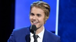 Justin Bieber speaks at the Comedy Central Roast of Justin Bieber at Sony Pictures Studios in Culver City, Calif., on Saturday, March 14, 2015. (Chris Pizzello / Invision)