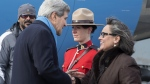 United States Secretary of State John Kerry is greeted by Leona Aglukkaq, Canadian Minister for the Arctic Council, as he arrives in Iqaluit, Nunavut, Friday, April 24, 2015. (Paul Chiasson / THE CANADIAN PRESS)