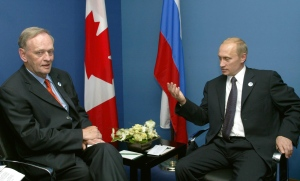 Russian President Vladimir Putin, right, gestures while speaking with Jean Chretien during a bi-lateral meeting at the Hotel Royal in Evian, France, Monday June 2, 2003. (AP / Misha Japaridze)
