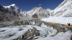 Tents are seen set up for climbers on the Khumbu Glacier, with Mount Khumbutse, centre, and Khumbu Icefall, right, seen in background, at Everest Base Camp in Nepal on Saturday, April 11, 2015. (AP / Tashi Sherpa)