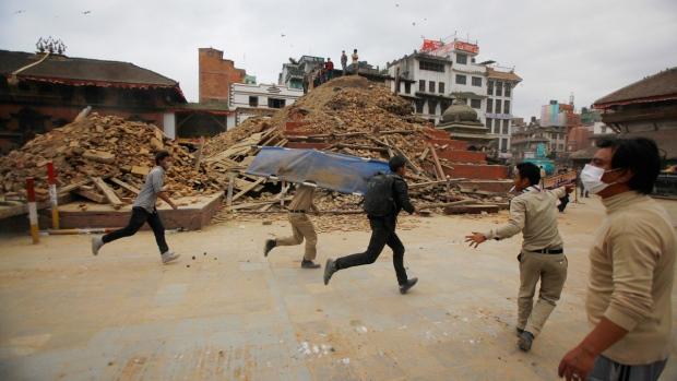 Volunteers run with a stretcher in Kathmandu