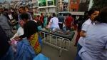 An injured child receives treatment outside Medicare Hospital in Kathmandu, Nepal, Saturday, April 25, 2015. (AP / Niranjan Shrestha)