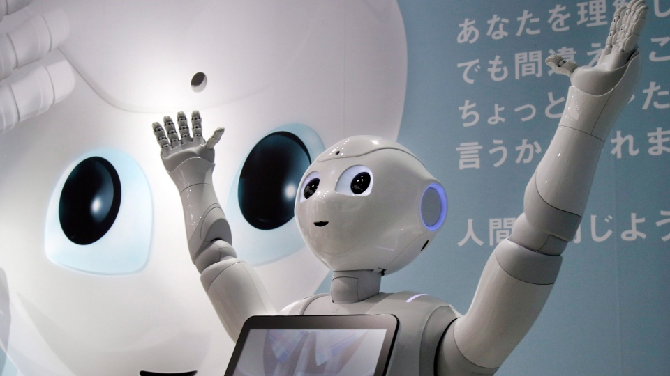 Humanoid Robot 'Pepper' is displayed at SoftBank Mobile shop in Tokyo on June 6, 2014. (AP / Koji Sasahara)