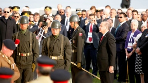 Turkish President Recep Tayyip Erdogan, centre right, stands in attention after placing a wreath during a ceremony at the Helles Memorial in the Gallipoli peninsula, Friday, April 24, 2015. (AP / Lefteris Pitarakis)