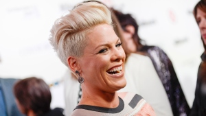 In a Dec. 10, 2013 file photo, singer Pink arrives at the Billboard Women In Music Awards in New York. (Evan Agostini /Invision / AP Photo)