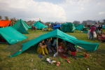 Nepalese take shelter in makeshift tents in an open ground from fears of earthquake tremors in Kathmandu, Nepal, Sunday, April 26, 2015. (AP / Niranjan Shrestha)