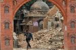 A Nepalese man cries as he walks through the earthquake debris in Bhaktapur, near Kathmandu, Nepal, Sunday, April 26, 2015. (AP / Niranjan Shrestha)