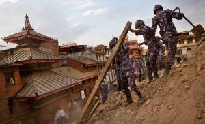 Nepalese policemen clear the debris at Basantapur Durbar Square, damaged in Saturday's earthquake, in Kathmandu, Nepal, Sunday, April 26, 2015.  (AP/Bernat Armangue)