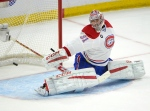 Montreal Canadiens' Carey Price (31) makes a save against Ottawa Senators' Kyle Turris (7) (not shown) during the first period of an NHL Stanley Cup playoff hockey game on April 26, 2015, in Ottawa. (Justin Tang / The Canadian Press)