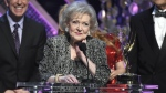 Betty White accepts the lifetime achievement award at the 42nd annual Daytime Emmy Awards at Warner Bros. Studios in Burbank, Calif. on April 26, 2015. (AP / Invision, Chris Pizzello)