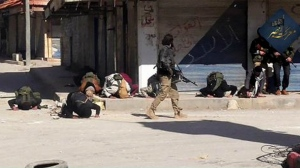 Fighters praying after rebel fighters from Islamic factions, including the Nusra Front captured the town of Jisr al-Shughour from Syrian government forces, in Idlib province, Syria in this image posted on the Twitter page of Syria's al-Qaida-linked Nusra Front on April 25, 2015. (AP)