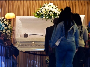 The body of Freddie Gray lies inside his casket at Vaughn Greene Funeral Home, during his wake Sunday, April 26, 2015 in Baltimore. (AP Photo/Jose Luis Magana)