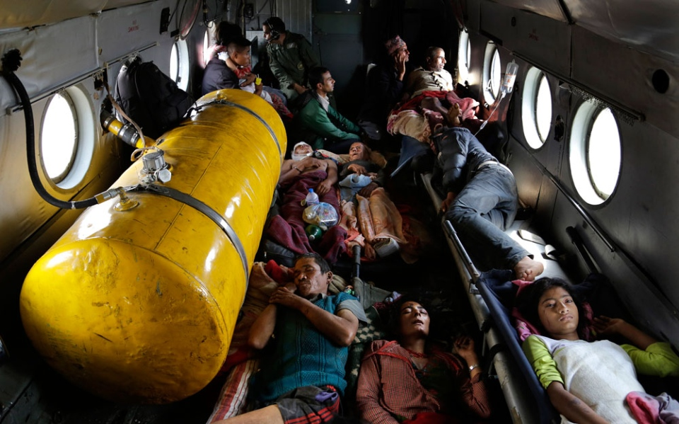 Nepalese soldiers carry a wounded woman to a waiting Indian air force helicopter as they evacuate victims from Trishuli Bazar to Kathmandu airport in Nepal, Monday, April 27, 2015. (AP / Altaf Qadri)