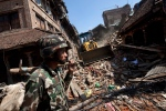 A member of the Nepalese army walks through a damaged area in Bhaktapur on the outskirts of Kathmandu, Nepal, Monday, April 27, 2015. (AP / Niranjan Shrestha)