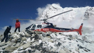 In this photo provided by Azim Afif, a helicopter prepares to rescue people from camp 1 and 2 at Everest Base Camp, Nepal on Monday, April, 27, 2015. (AP / Azim Afif)