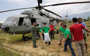 Nepalese volunteers unload relief material brought in an Indian air force helicopter for victims of Saturday's earthquake at Trishuli Bazar in Nepal, Monday, April 27, 2015. (AP / Altaf Qadri)